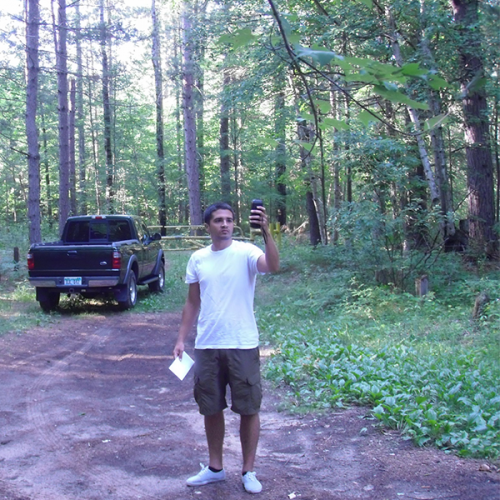 Intern Phil with Michigan DNR using GIS to assess recreational use of Au Sable State Forest, Grayling, MI