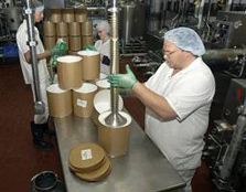 Filling ice cream tubs in dairy plant