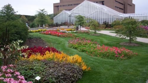 The plant and soil sciences building, greenhouses, and gardens in bloom