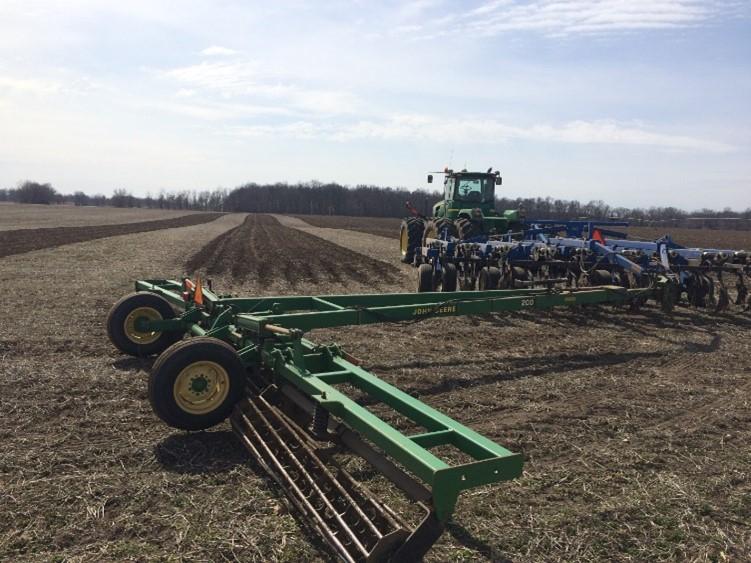 Tilling soil.