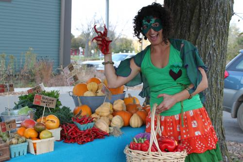 "Hether Frayer dressed as ""The Fresh Food Fairy."" Proceeds from the calendars will support her work."