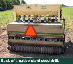 Back of a native-plant seed drill.