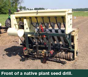 The front of a native plant seed drill.