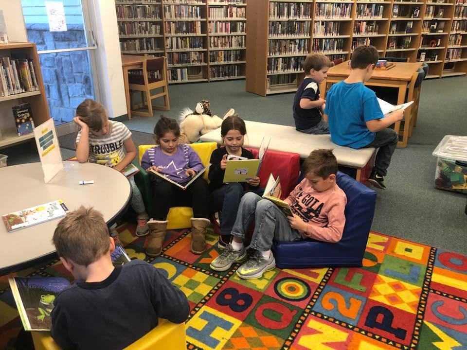 Kids reading in library