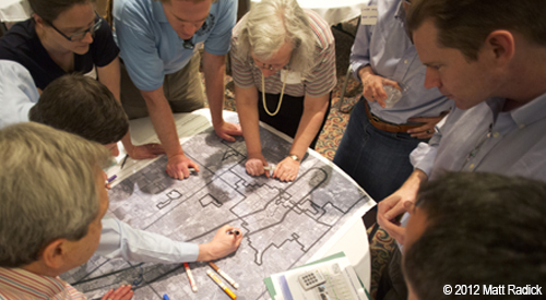 Group reviews plan documents at the Grand River Charrette