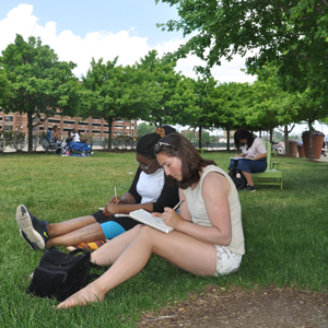 Students sitting in a park at Belle Isle sketching idease for their Student Parks Project