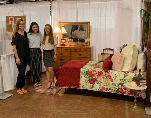 Third place team in the bedroom they designed.