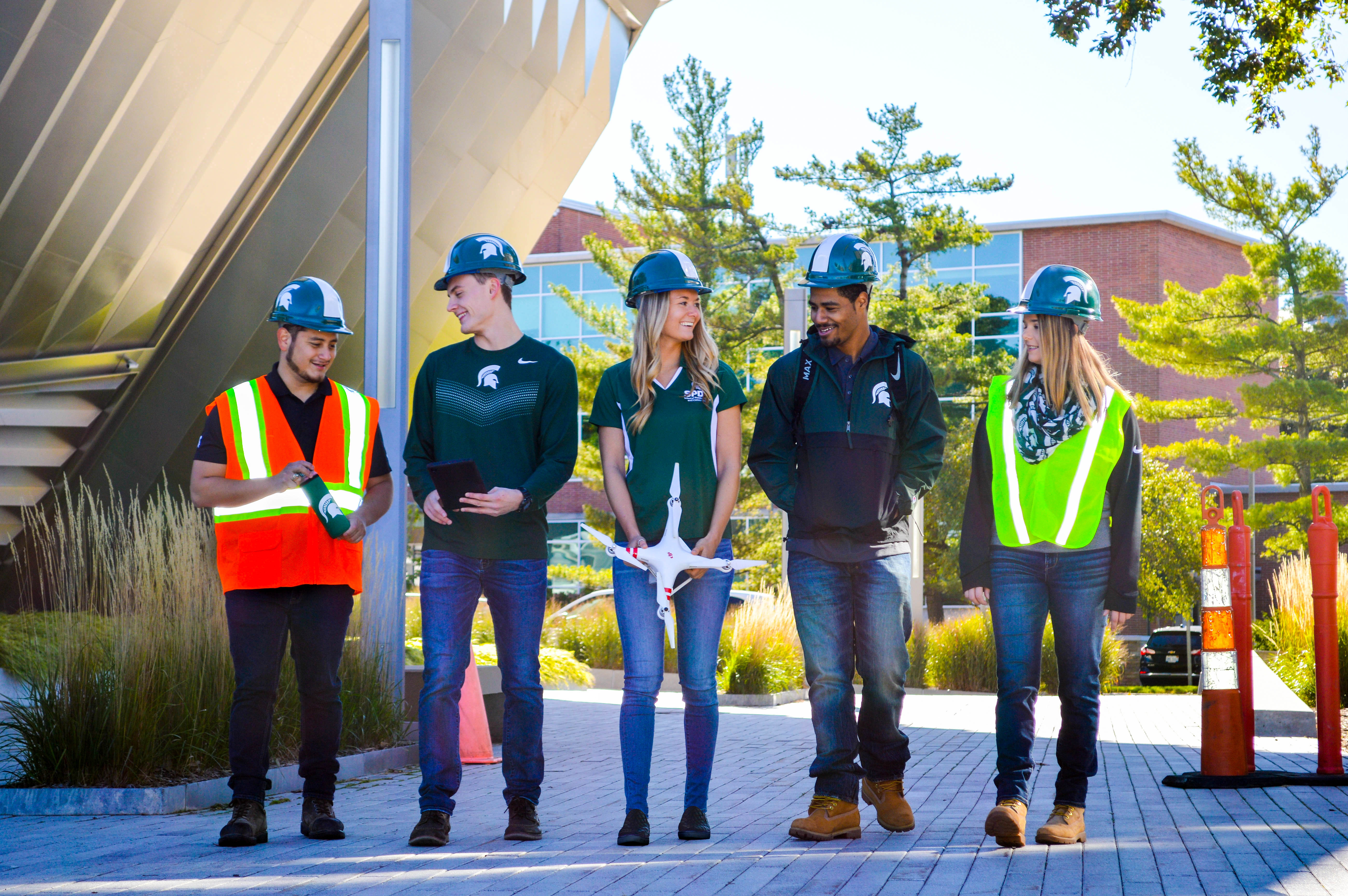 Construction management students walking together and talking.