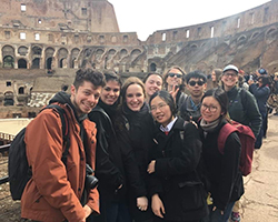 Class photo at the Colosseum in Rome, Italy.