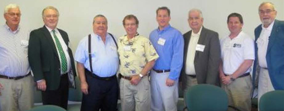 Photo of several construction management alumns.