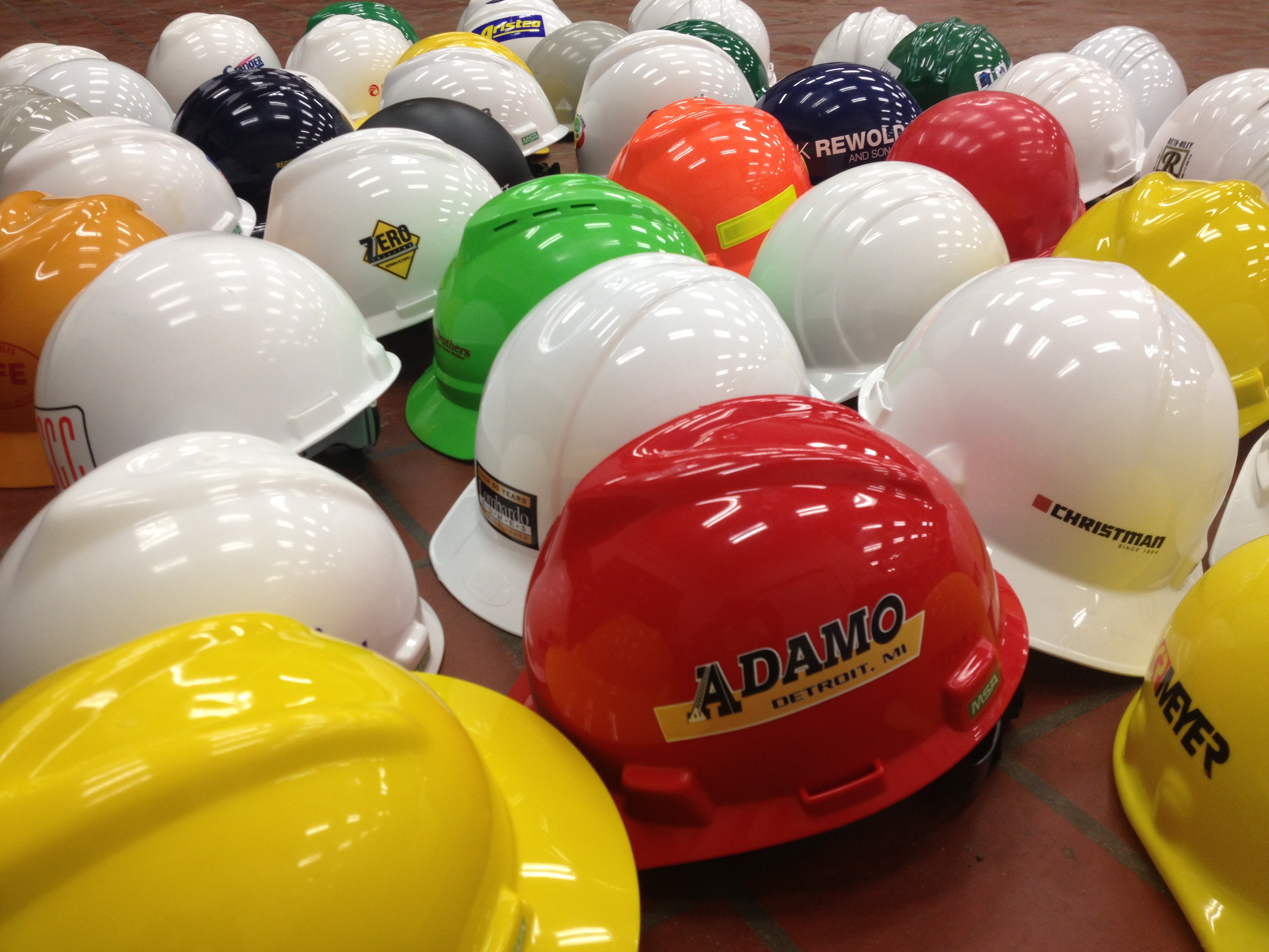 Photo showing several hard hats grouped together.