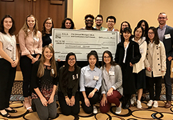Students receive a Michigan American Society of Landscape Architects scholarship check.