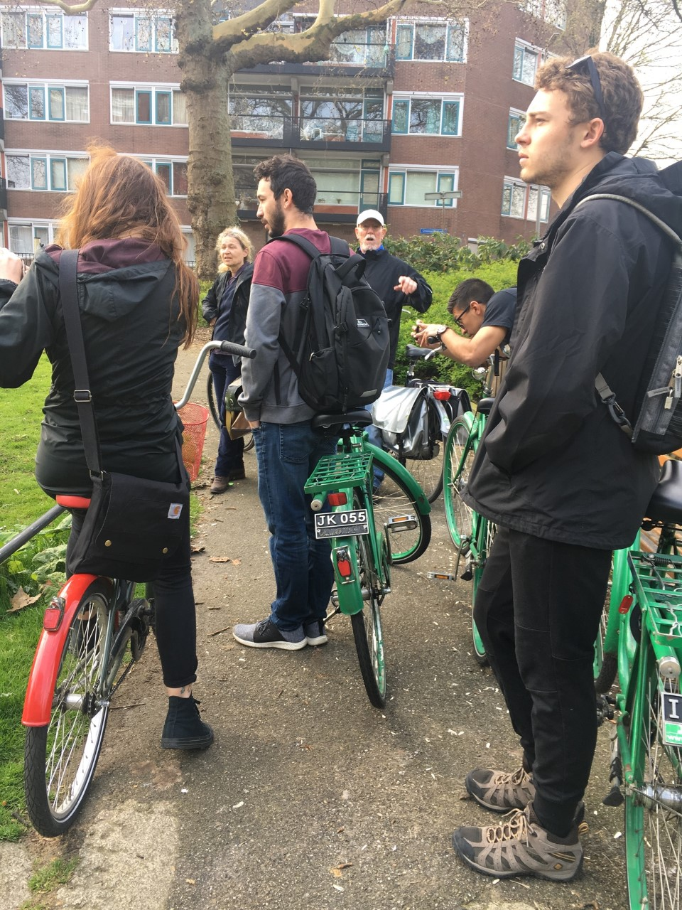 Students standing with bicycles.