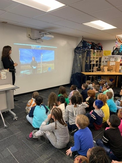 students watching virtual field trip in classroom