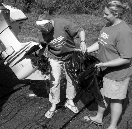Volunteers cleaning up a boat propeller