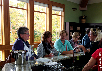 Wine tasting room visitors. Photo by Joy Landis