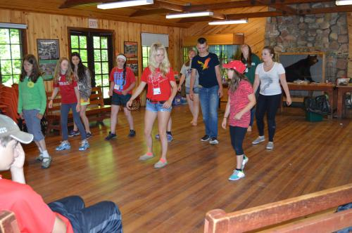 Hannah line dancing with campers