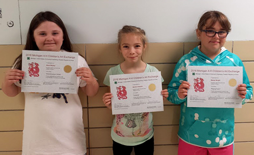 Elementary students with their certificates