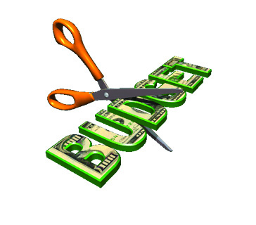 Scissors cutting budget dollars