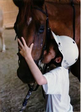 ACEE poster of child kissing a horse