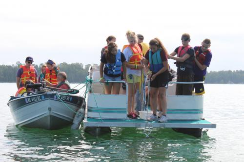 Great Lakes and Natural Resources Campers exploring the lake on a boat.