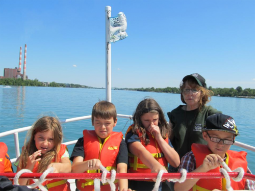 Students on a shipboard excursion in the Detroit area.