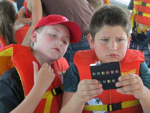 Students learning on a shipboard excursion in the Detroit area.
