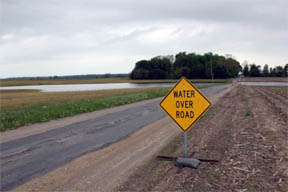 """Water over road"" sign"