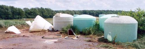 Collapsed poly tanks. Photo credit: Jack Knorek, Michigan Department of Agriculture and Rural Development