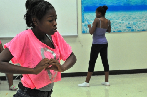 4-H youth rehearse a dance they choreographed.