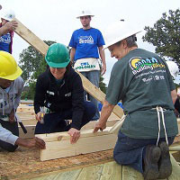 Volunteers building a foundation