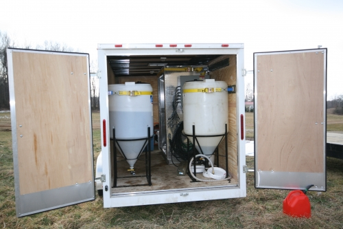 A biodiesel processor mounted in the back of a 16 foot cargo trailer.