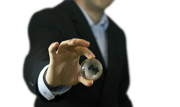 Business man holding a mini glass globe