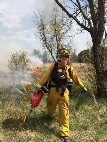 Hilary Wells, igniting a prescribed fire