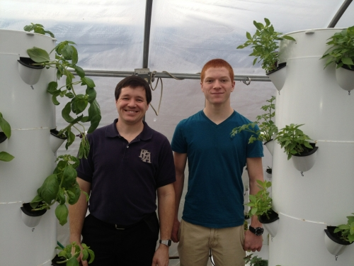 Olivet High School Agriscience Teacher and FFA Advisor Doug Pennington and high school student and 4-H member Dalton Humphrey pose next to hydroponic garden structures. Photo courtesy of Christine Sisung.