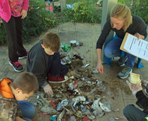 Students review debris they recovered at Rotary Island