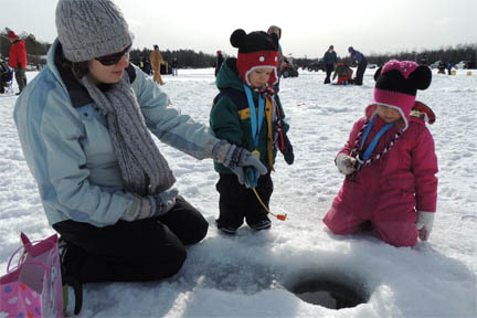 Mother and children ice fishing imabe.