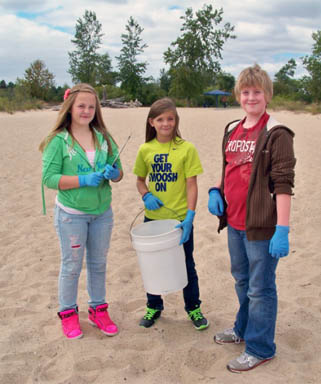 Students doing Adopt-A-Beach clean up image.