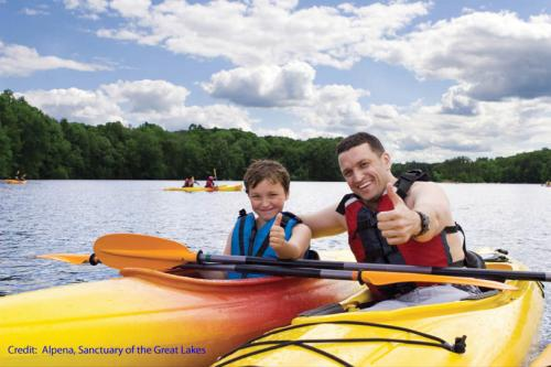 Father and son kayaking image.