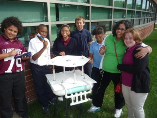 Harper Woods Middle School students working with basic observation buoy (BOB) image.