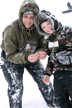 Father and son ice fishing in Michigan image.
