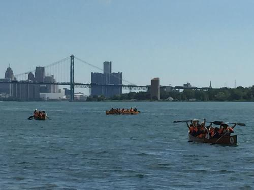 Canoes full of people on the Detroit River