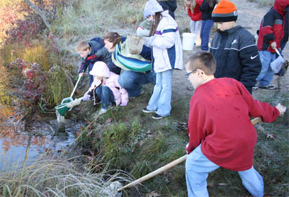 Students gathering samples for an experiment.
