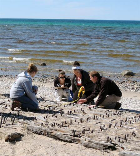 Students examing beach site of Katherine V shipwreck