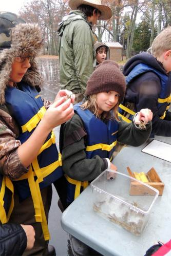 Students examining cray fish samples image.
