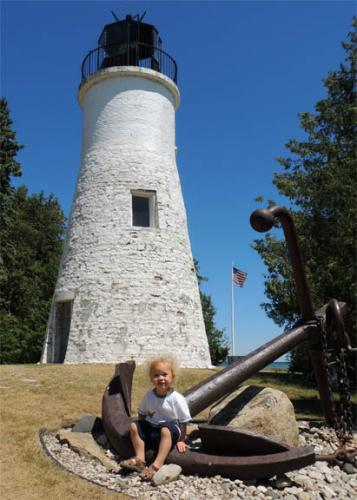 Child at a lighthouse image.