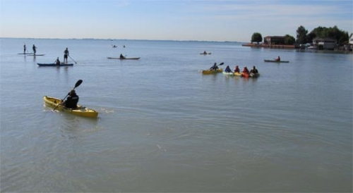 Group of kayakers on the Great Lakes.