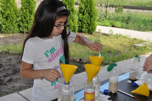 Young girl with science experiment