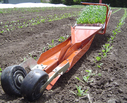 Paper pot transplanter, ready to plant. Photo courtesy of Small Farm Works.