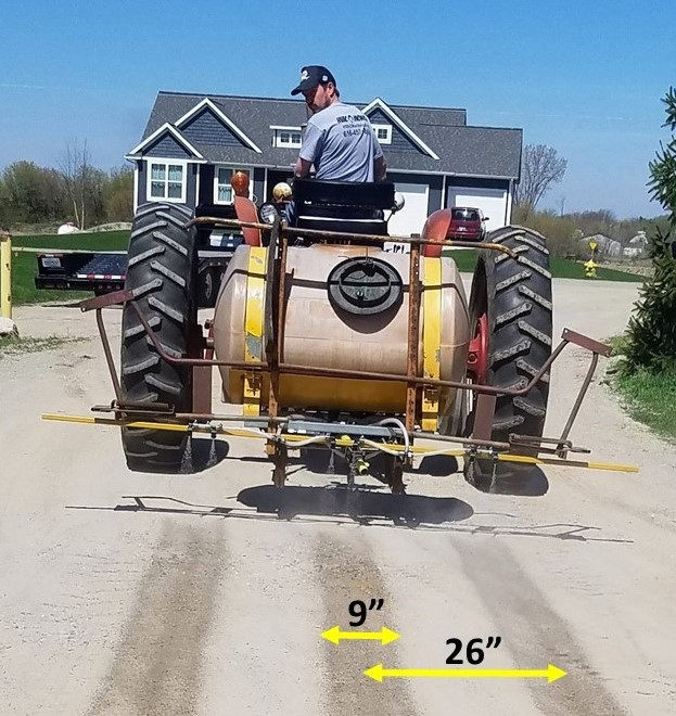 Grower on a sprayer tractor